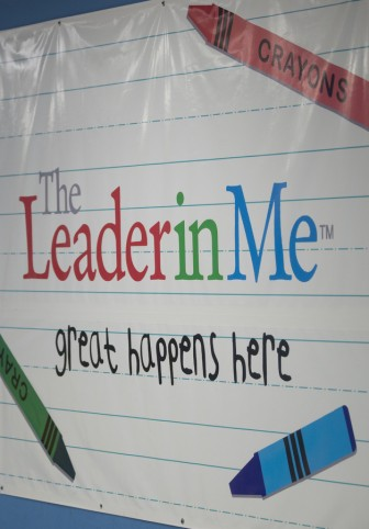Mottos, mission statements and motivational signs abound in the school. Photo by Walt Stricklin