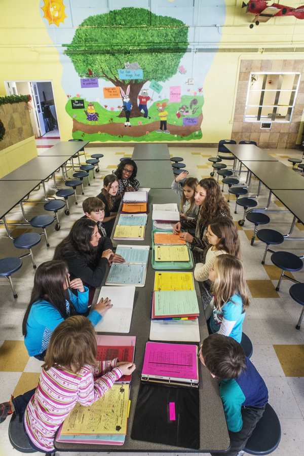Hueytown students,  teachers gather in  lunchroom to review Data Binders. Photo by Walt Stricklin