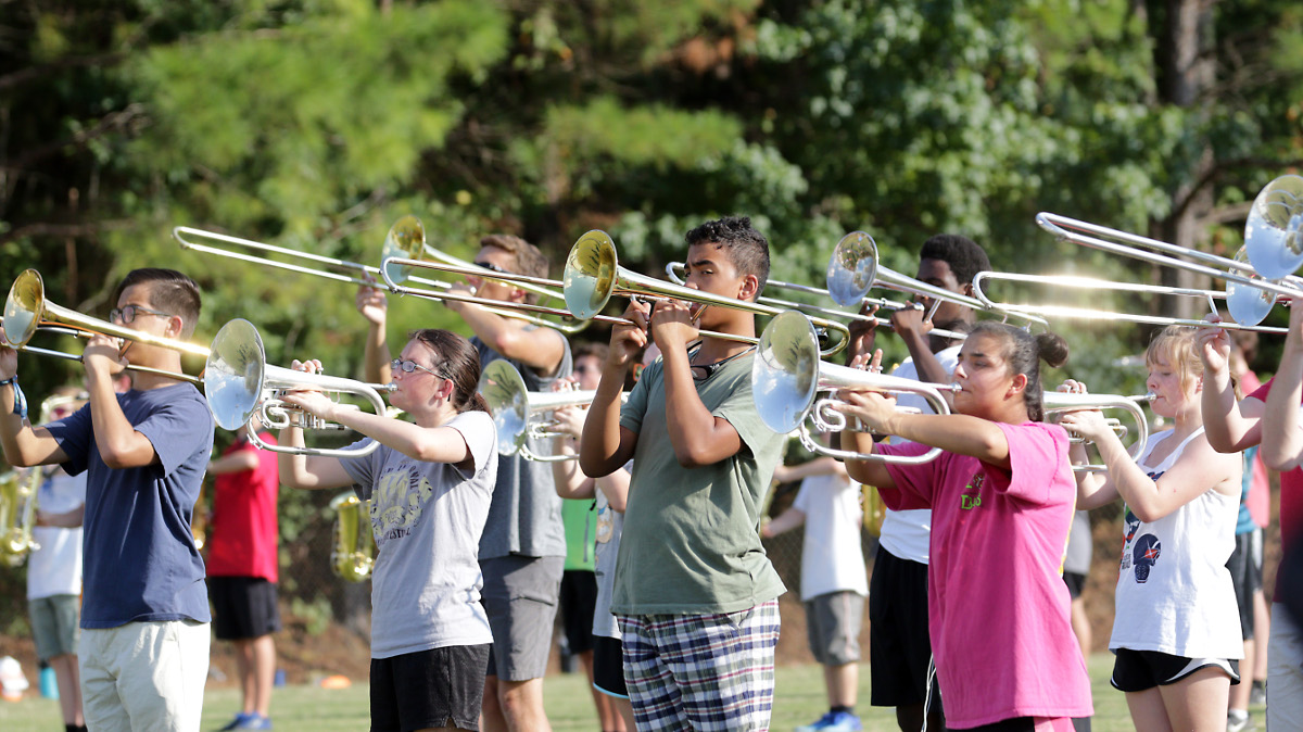 Hoover band heads outside to find room to practice. Photo: Marvin Gentry