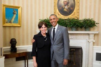 Ann Marie Corgill poses with President Obama in the Oval Office before the Rose Garden Ceremony recognizing Teachers of the Year.