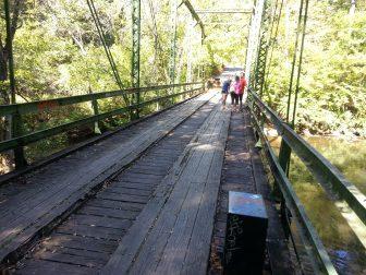 Visitors gather on rustic bridge. Photo Credit: Hank Black