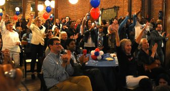 Cheers erupt early in the evening as Hillary Clinton takes a lead during a Jefferson County Democratic Party watch party at B&A Warehouse.